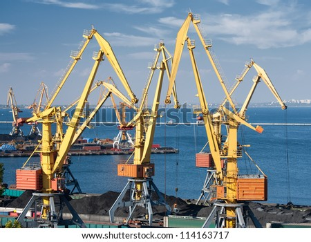 industrial port and cranes - stock photo