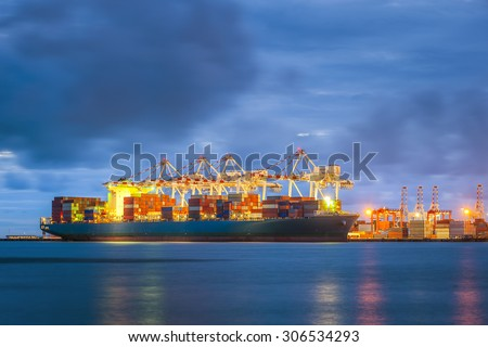 Industrial port at dawn at the Port of Leamchabang, Thailand - stock photo