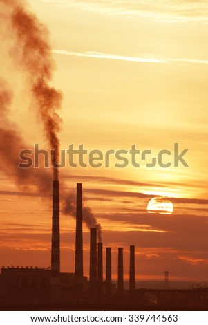 Industrial power at sunrise against the sky - stock photo