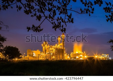 Industrial power plant at twilight. - stock photo