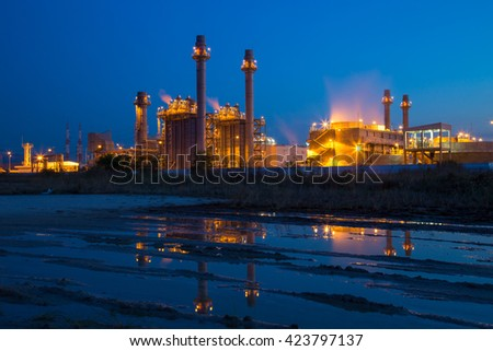 Industrial power plant at twilight - stock photo