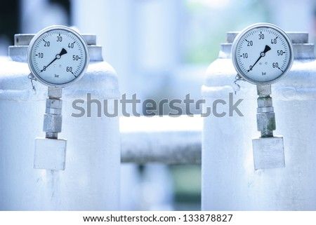 Industrial pressure meter with tank - stock photo