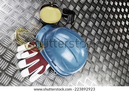 industrial protective clothing, gear, hard-hat, glasses and ear-protection - stock photo