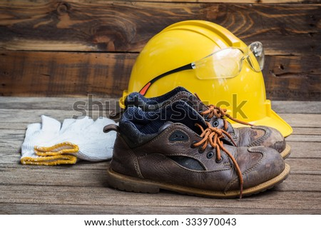 Industrial Protective Workwear. Includes leather boots, safety glasses, gloves and hardhat - stock photo