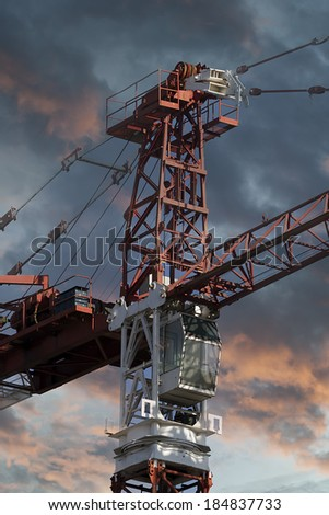Industrial red crane, sunset background, construction and works - stock photo