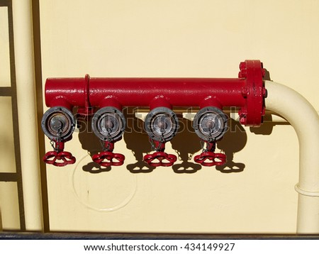 Industrial red fire hydrant emergency gear on a boat - stock photo