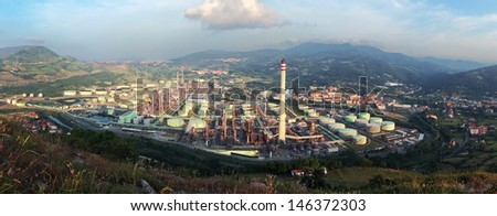 industrial refinery plant  in a natural environment. Muskiz, Basque Country, Spain - stock photo