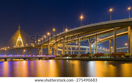 Industrial Ring Bridge across river during twilight - stock photo