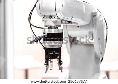 Industrial robot arm - stock photo