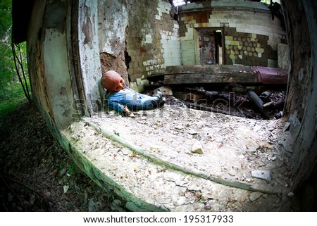 Industrial Ruins with old baby doll, toned photo, fisheye effect - stock photo