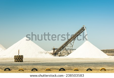 Industrial salt refinery with operating conveyor belt - Emerging industries area in Namibia - stock photo