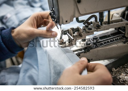 Industrial sewing big machine - stock photo