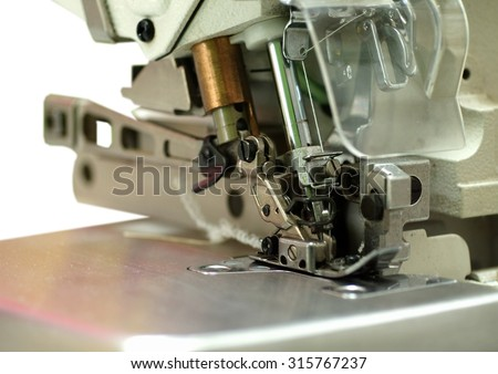 industrial sewing machine close up details die-cut isolated on white background - stock photo