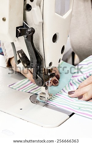 Industrial sewing machines sewing machine operator with chain - stock photo