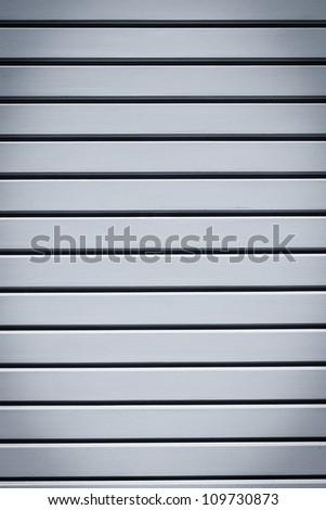 Industrial shiny grey metal door background - stock photo