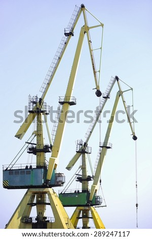 Industrial shipping cranes for containers in a harbor - stock photo