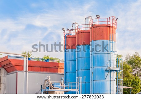 Industrial silos for the production of cement - stock photo
