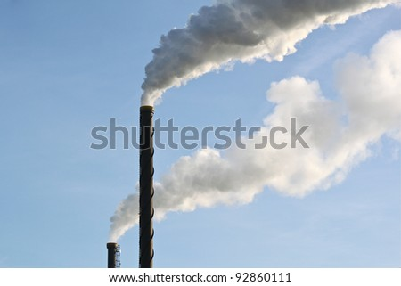 Industrial smoke from two chimneys - stock photo