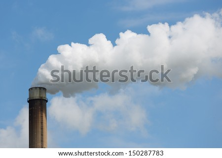 Industrial smoke stack of a power plant. - stock photo