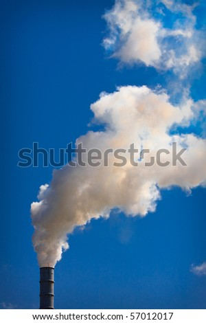 Industrial Smokestack On A Beautiful Summer Day - stock photo