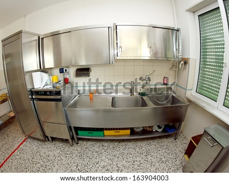 industrial stainless steel sink kitchen of a school canteen very clean - stock photo