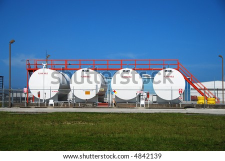 Industrial storage facility with jet fuel canisters - stock photo