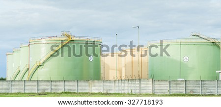 Industrial Storage Tanks. Oil tanks in two lines - stock photo