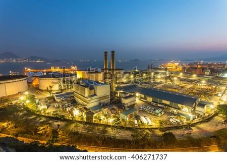 Industrial tanks at night in Hong Kong - stock photo