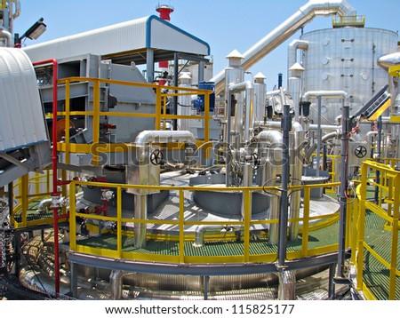 Industrial tanks, pipes, pumps, instrumentation, motor - stock photo