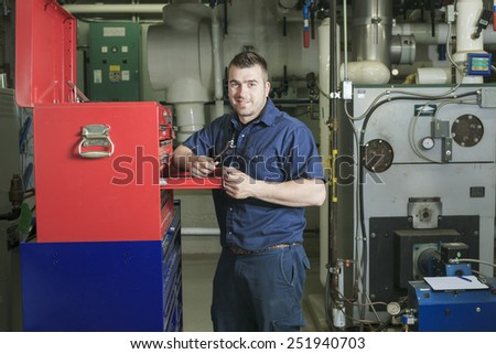 industrial technician inside a industrial place - stock photo