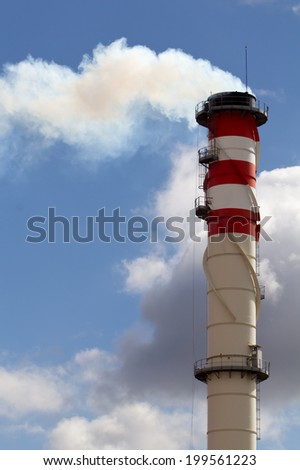 Industrial tower where out toxic fumes - stock photo