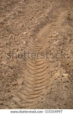 industrial tractor footprint on - stock photo