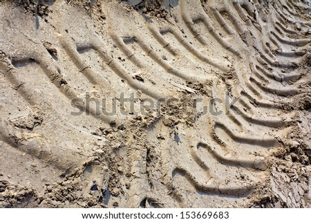 Industrial tractor tire footprint on soil - stock photo