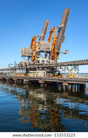 Industrial view - Crane loader and conveyors to transport coal. - stock photo