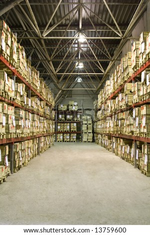 Industrial warehouse with plenty of boxes - stock photo