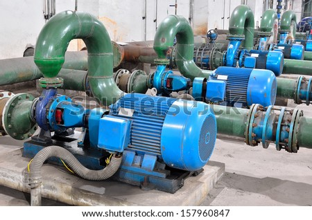 Industrial water pump station --  sewage treatment plant within the pumps and pipelines   - stock photo
