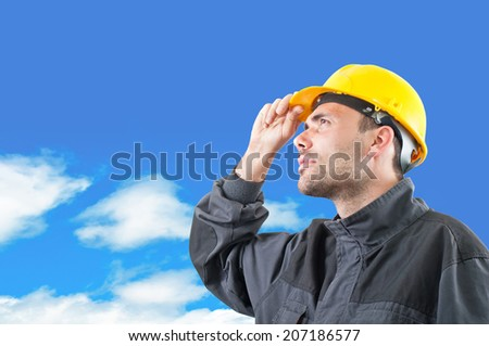 industrial worker with yellow helmet facing high  - stock photo