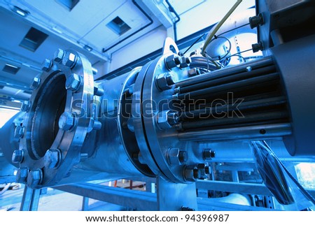 Industrial zone, Steel pipelines and cables in blue tones - stock photo
