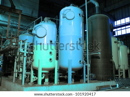 Industrial zone, Steel pipelines and storage tanks - stock photo