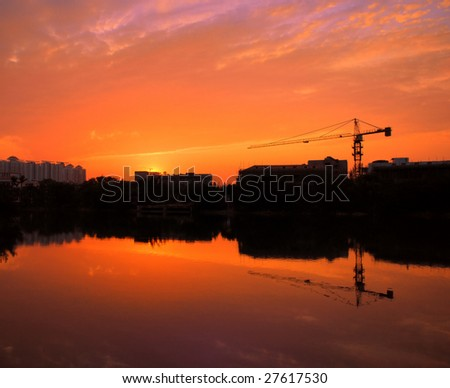 Industry and building at sunset with pink sky - stock photo