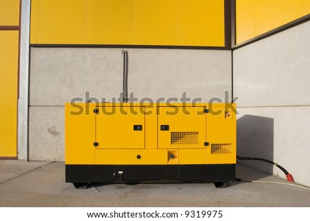 Industry background. Yellow generator. Electric equipment - stock photo