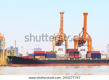 industry container ship on port for import export goods trading and shipping business - stock photo