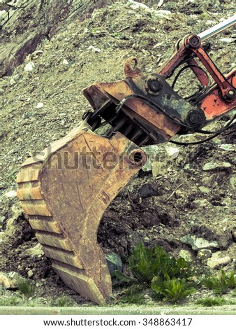 Industry, heavy duty excavator machine, digger bucket bulldozer shovel on construction site outdoor - stock photo