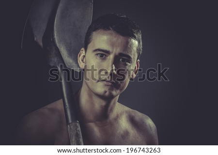 Industry, Male worker holding a shovel, sexy builder - stock photo