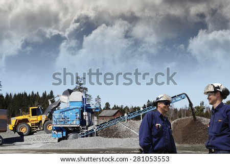 industry workers and stone quarry works, bulldozers and trucks - stock photo