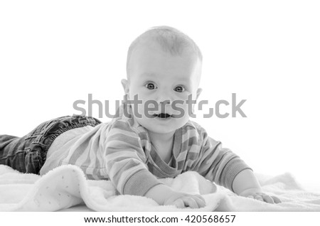 Infant baby boy smiling on a white blanket isolated on white - stock photo