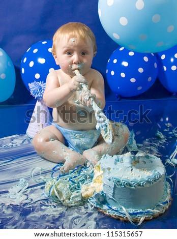 Infant boy's first birthday cake smash - stock photo