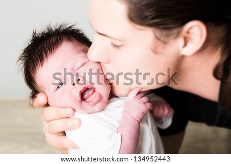 Infant boy with father in studio - stock photo