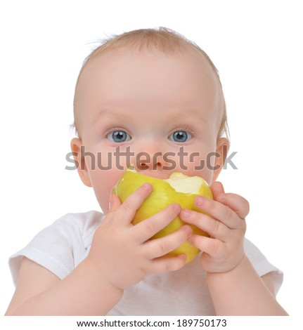 Infant child baby girl eating apple closeup isolated on a white background - stock photo