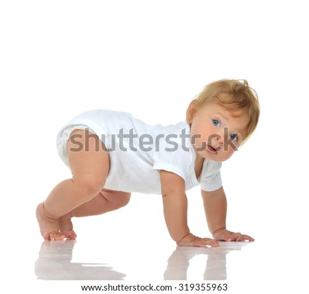Infant child baby girl in diaper crawling happy looking at the corner trying to stand up isolated on a white background - stock photo
